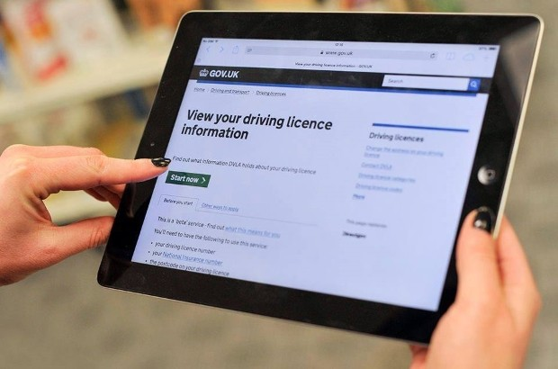 Person using an iPad to use the GOV.UK 'view driving licence information' page