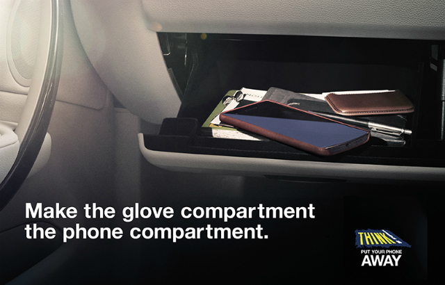 A mobile phone in a glove compartment.