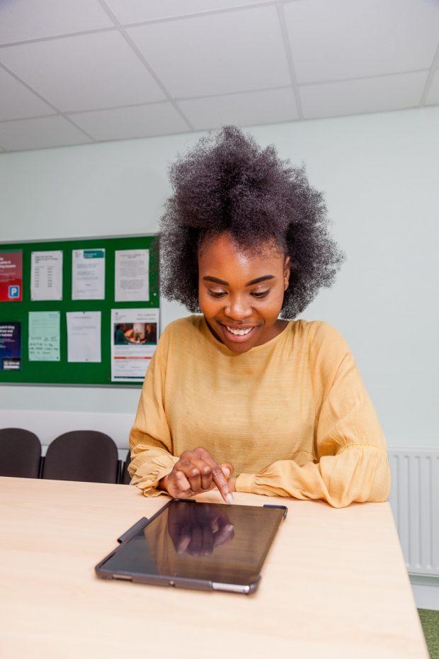 Girl using an ipad on a desk